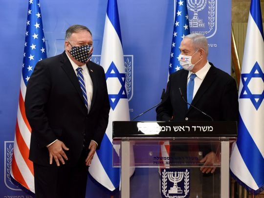 U.S. Secretary of State Mike Pompeo, left, and Israeli Prime Minister Benjamin Netanyahu wear face masks to help prevent the spread of the coronavirus after they make joint statements to the press, in Jerusalem, Monday, Aug. 24, 2020.
