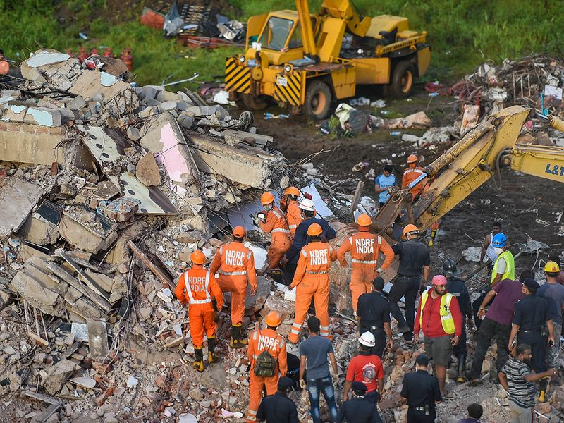 NDRF personnel sift through the rubble in search of survivors
