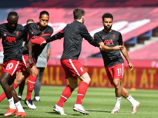 Liverpool's Mo Salah, Andrew Robertson, Virgil van Dijk and Sadio Mane warm up before the RB Salzburg match.