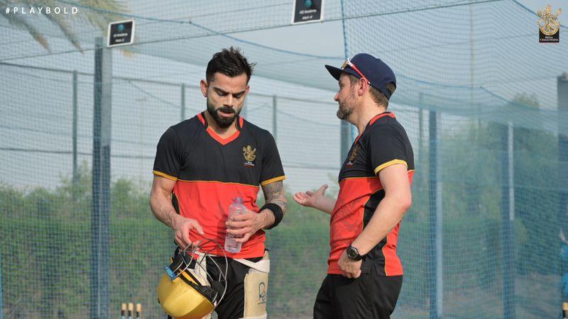 Kohli takes a breather during training in Dubai.