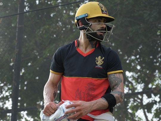 Viralt Kohli shows off his golden Royal Challengers Bangalore helmet in training in Dubai.