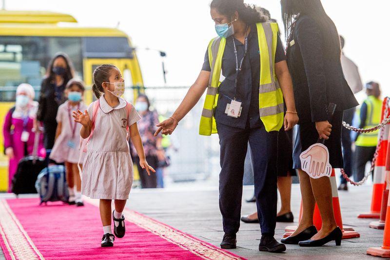 Kids arrive at the Gems New Millennium School Al Khail, Dubai.