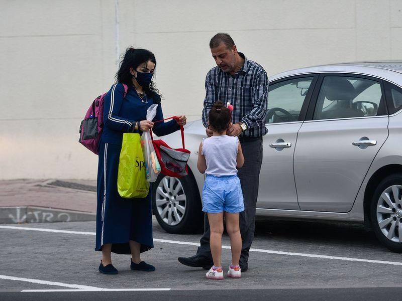 Parents drop their daughter at Al Rashid Al Saleh Private School in Dubai.