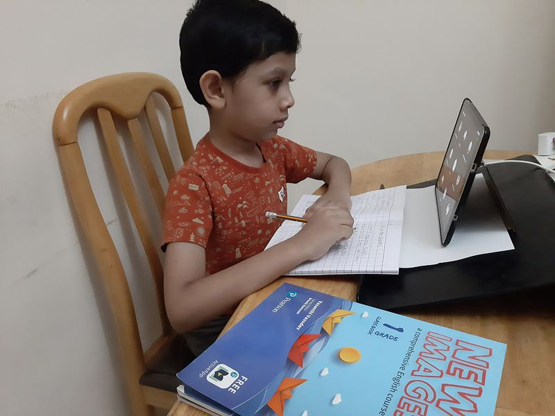 Parthiv Devadas of Grade 1, Our Own English high school, Sharjah (Boys branch) attends the e-Learning class on the first day of school after summer break.