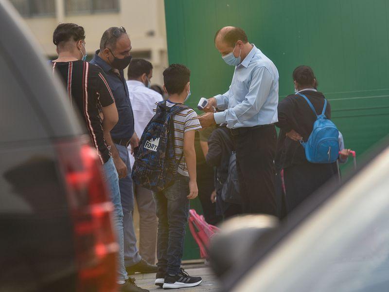 Students temperatures are checked before entering at the Al Rashid Al Saleh Private School in Dubai.