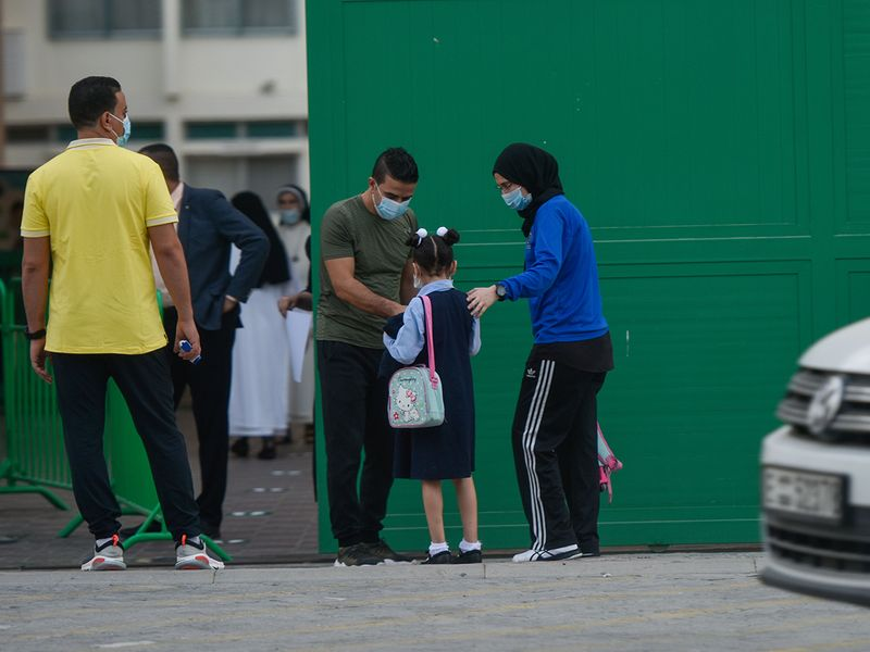 Students temperatures are checked before entering at the premises of Al Rashid Al Saleh Private School in Dubai.