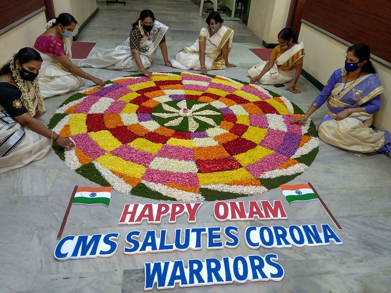 Keralite women make 'Pookolam' (flower decoration) on the occasion of Onam festival in Coimbatore.