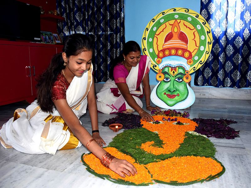 Malayali community people making art outside their house on the occasion of Onam in Ranchi (Jharkhand) on Monday.
