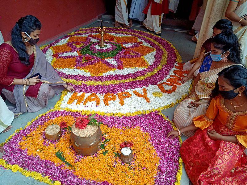Women making flower rangoli on the ocassion of Onam, in Indore (Madhya Pradesh).