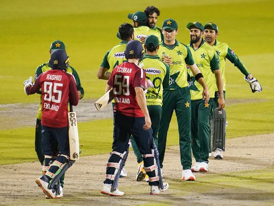 Pakistan players greet England batsmen after their win in the third Twenty20 cricket match, at Old Trafford in Manchester.