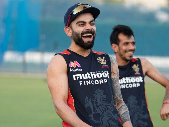 Royal Challengers Bangalore skipper Virat Kohli shares a laugh in training in Dubai