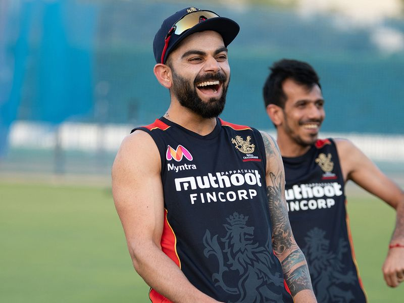 Royal Challengers Bangalore skipper Virat Kohli shares a laugh in training in Dubai
