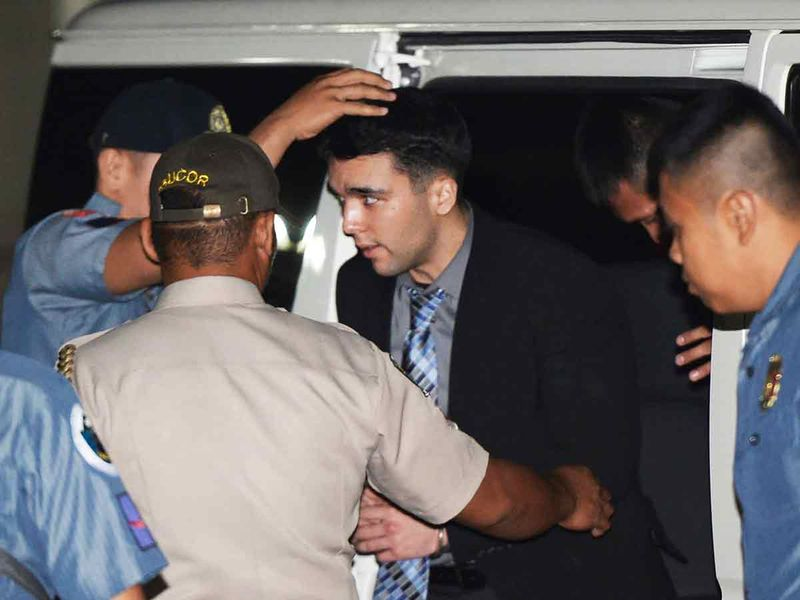 Convicted U.S. Marine Lance Cpl. Joseph Scott Pemberton is escorted to his detention cell upon arrival at Camp Aguinaldo at suburban Quezon city, northeast of Manila, Philippines.