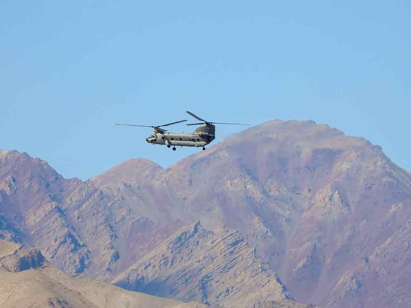 Indian Air Force (IAF) Chinook helicopter flies amid the prolonged India-China stand off in the Ladakh region, in Leh, Thursday, Sept. 3, 2020.