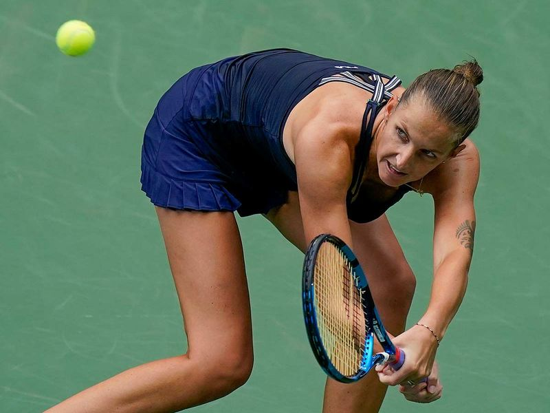 Karolina Pliskova, of the Czech Republic, returns a shot to Caroline Garcia, of France, during the second round of the US Open tennis championships, Wednesday