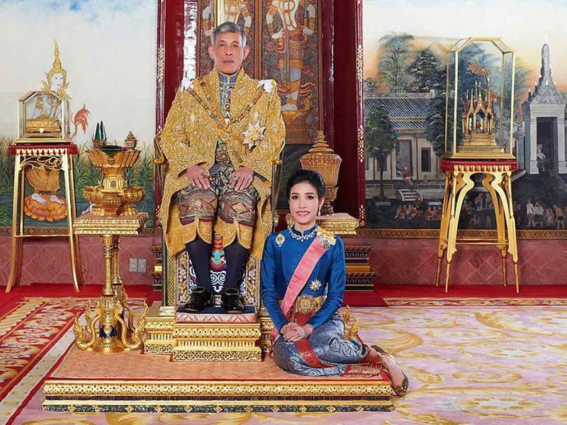 Thailand's King Maha Vajiralongkorn and General Sineenat Wongvajirapakdi, the royal noble consort pose at the Grand Palace in Bangkok, Thailand, in this undated handout photo obtained by Reuters September 2, 2020.