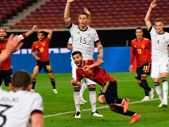 Spain's defender Jose Luis Gaya Pena celebrates his equaliser against Germany.