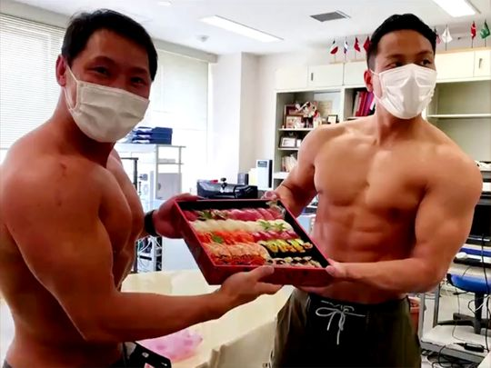 Japan sushi chef using bodybuilder delivery to buoy COVID-19 hit business
