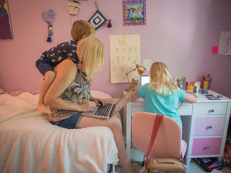 Mother remote learning daughter laptop US school