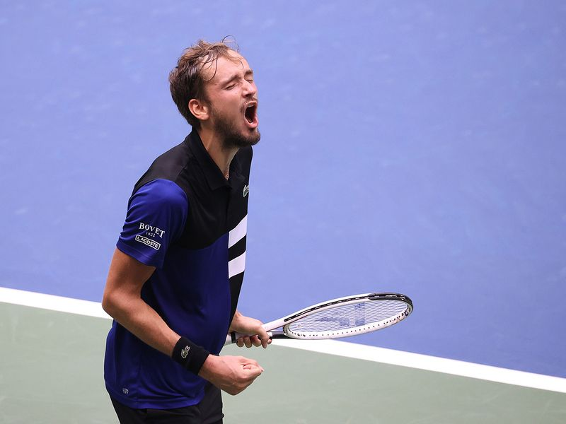 Daniil Medvedev of Russia celebrates winning match point against Andrey Rublev