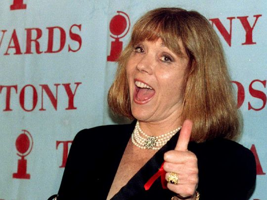 Diana Rigg gives the thumbs up sign as she holds her Tony Award for Best Performance by a Leading Actress in a Play in New York City, U.S., June 12, 1994.