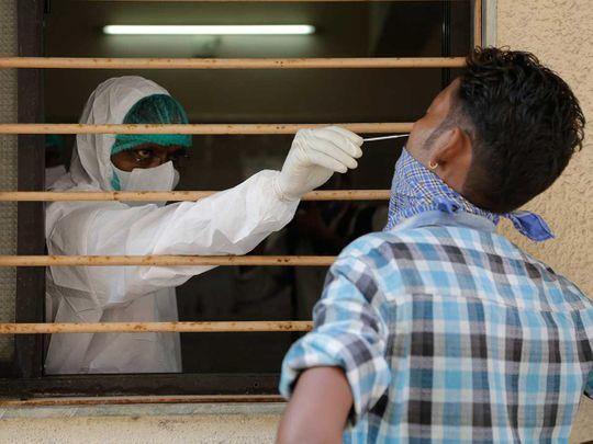 INdia health worker coronavirus covid swab sample