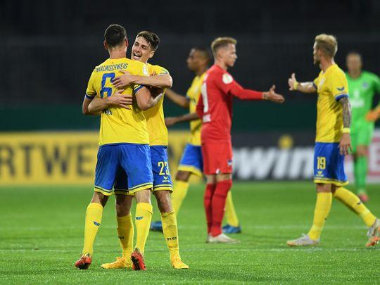 Eintracht Braunschweig's Dominik Wydra and Danilo Wiebe celebrate after beating Hertha Berlin
