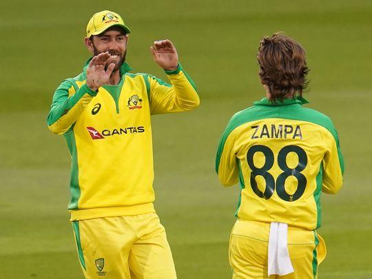 Glenn Maxwell celebrates with Australia's Adam Zampa after taking a catch to dismiss England's Eoin Morgan
