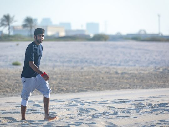 Mumbai Indians' Jasprit Bumrah relaxes on the beach in Abu Dhabi.