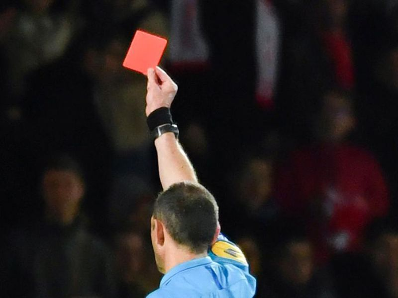 Referee shows the red card
