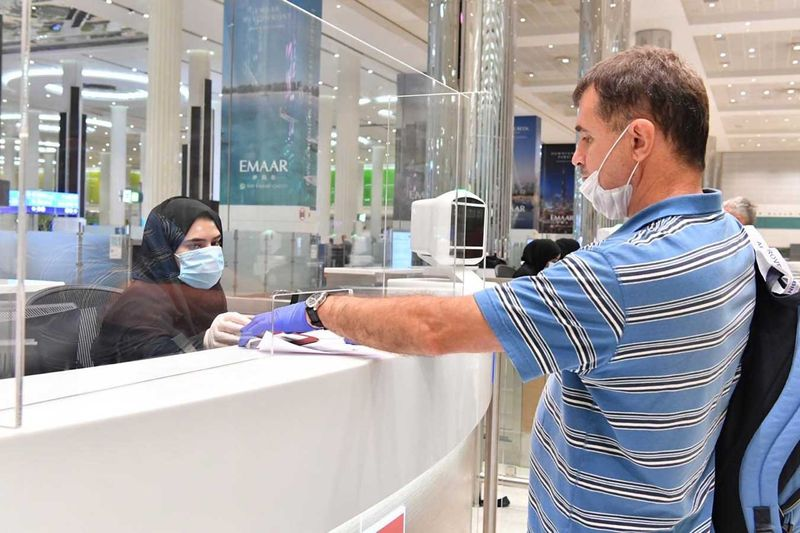 A Russian passenger goes through immigration at Dubai airport.