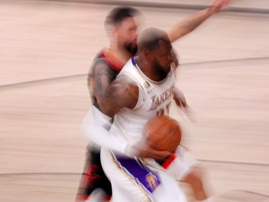 LeBron James of the Los Angeles Lakers drives to the basket against the Houston Rockets in Game Five of the Western Conference semi-finals.