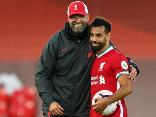 Liverpool boss Jurgen Klopp congratulates Mo Salah on his hat-trick against Leeds United.