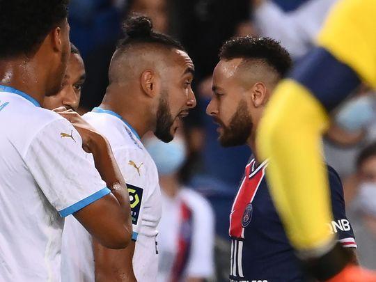 Paris Saint-Germain's Brazilian forward Neymar argues with Marseille's Dimitri Payet