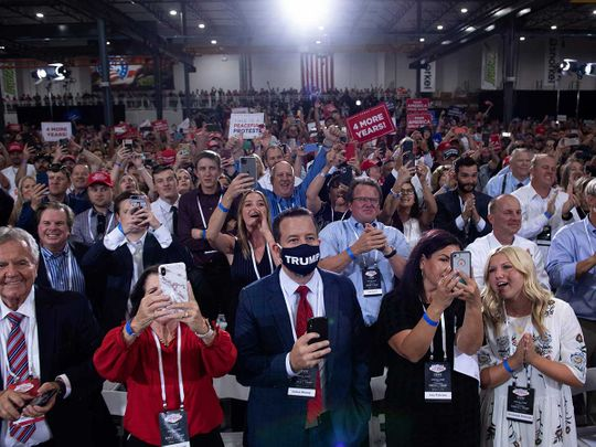 People cheer campaign for Trump
