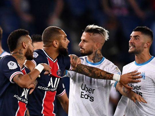 Neymar, left, gets involved in the brawl between PSG and Marseille