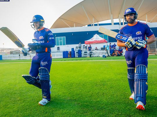 Rohit Sharma, right, and Quiton De Kock prepare to open the batting for Mumbai Indians during a practice match