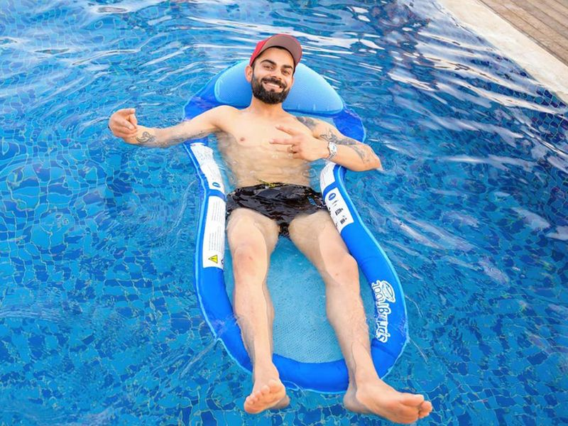 Royal Challengers Bangalore's Virat Kohli relaxes in the pool