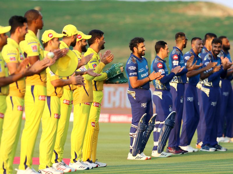 Chennai Superkings and Mumbai Indians players stand and clap as they thank you the front line heroes before the start of the match 1 of season 13 of the Dream 11 Indian Premier League (IPL) between the Mumbai Indians and the Chennai Superkings held at the Sheikh Zayed Stadium, Abu Dhabi in the United Arab Emirates on the 19th September 2020. Photo by: Vipin Pawar / Sportzpics for BCCI