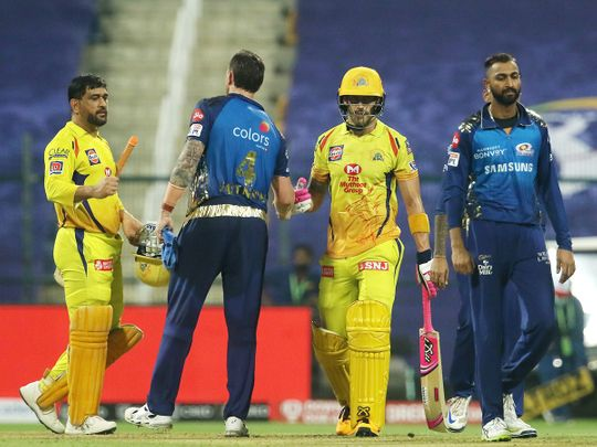Mumbai Indians and Chennai Super Kings players greet each other after the match.