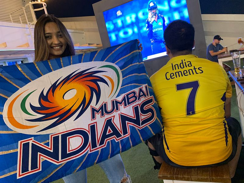 Supporters watching the IPL match between Mumbai and Chennai