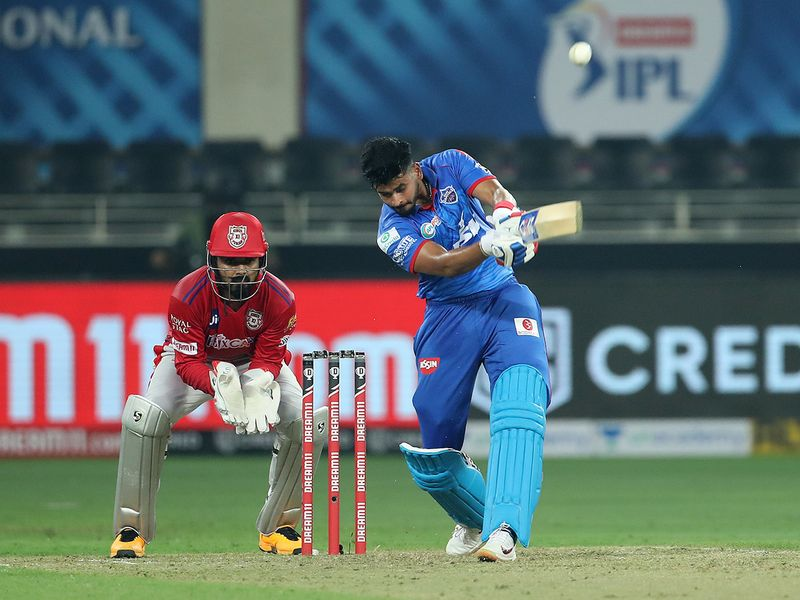 Captain of Delhi Capitals Shreyas Iyer hits over the top for six.
