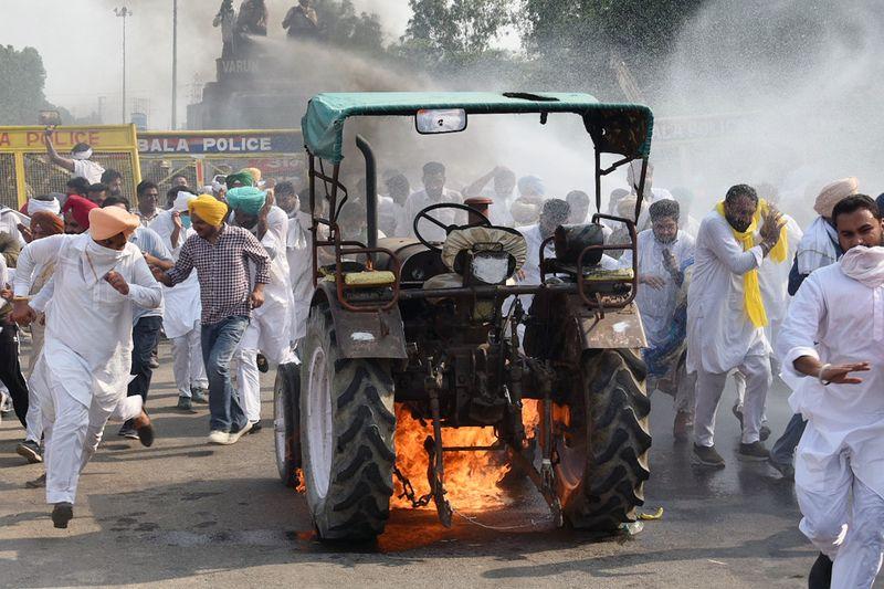 India lawmakers pass farm bills amid uproar in Parliament