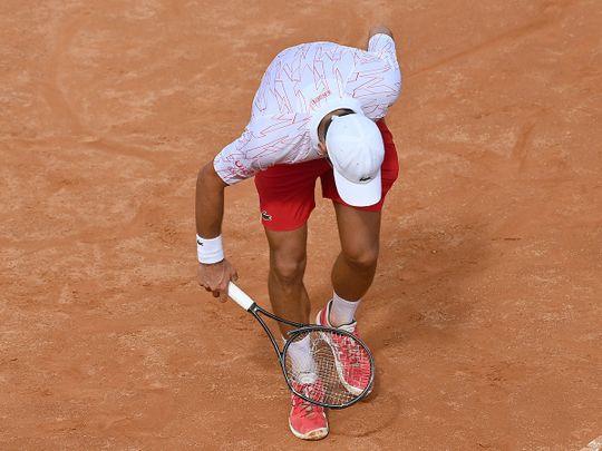 Novak Djokovic smashes his racket in the Italian Open
