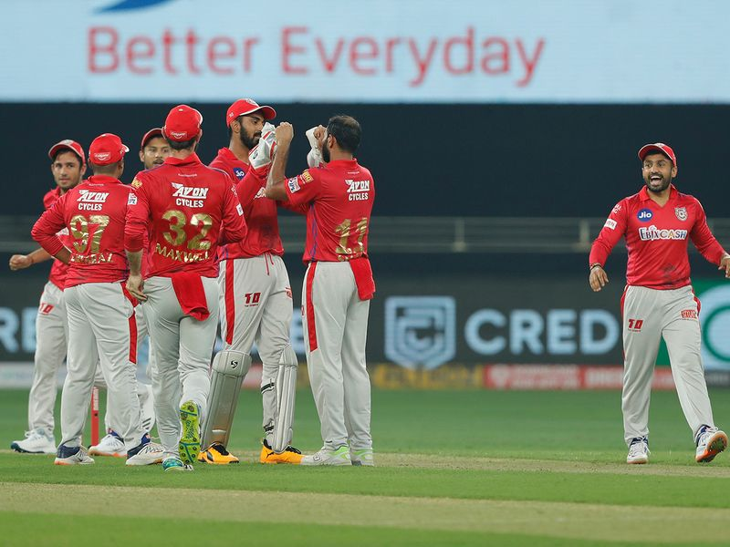 The Kings XI Punjab players celebrates the wicket of Hetmyer.