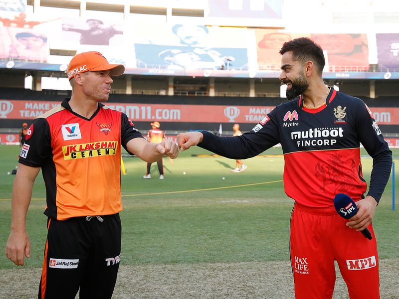 David Warner and Virat Kohli are seen during the toss.