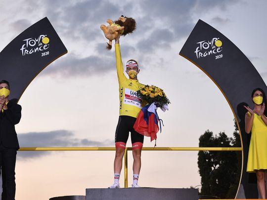 Tadej Pogacar celebrates his Tour de France win