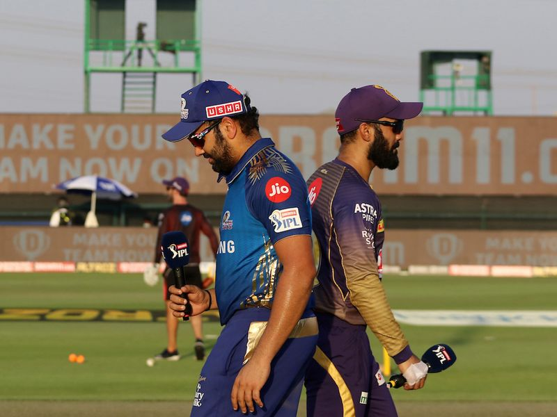Dinesh Karthik captain of Kolkata Knight Riders and Rohit Sharma captain of Mumbai Indians during the toss of the match 5 of season 13 of the Dream 11 Indian Premier League (IPL) between the Kolkata Knight Riders and the Mumbai Indians held at the Sheikh Zayed Stadium, Abu Dhabi in the United Arab Emirates on the 23rd September 2020. Photo by: Vipin Pawar / Sportzpics for BCCI