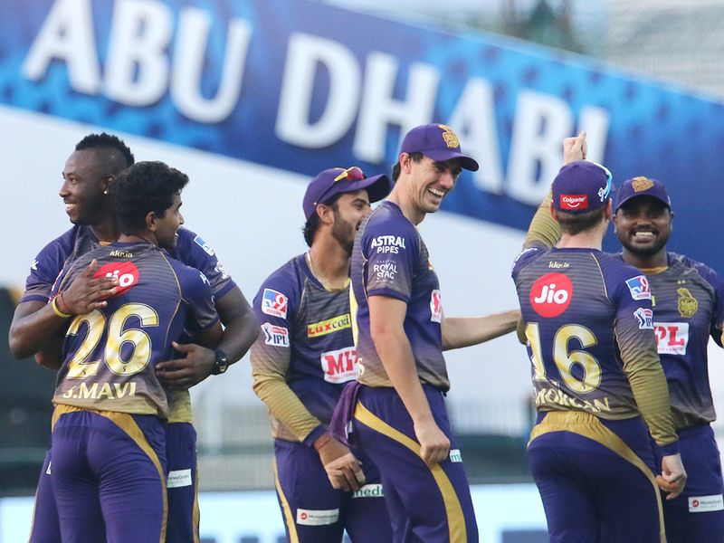 Kolkata Knight Riders players celebrate the wicket of Quinton de Kock of Mumbai Indians.