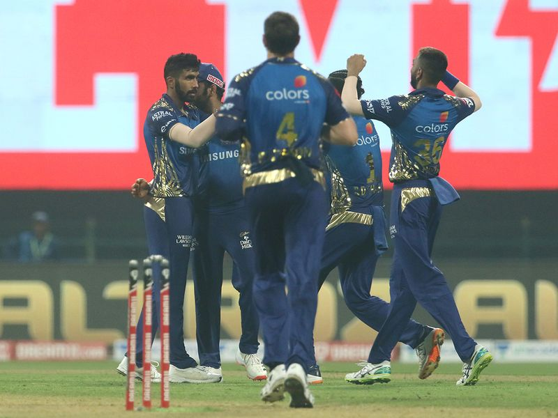 Mumbai Indians players celebrate the wicket of Andre Russell of Kolkata Knight Riders.